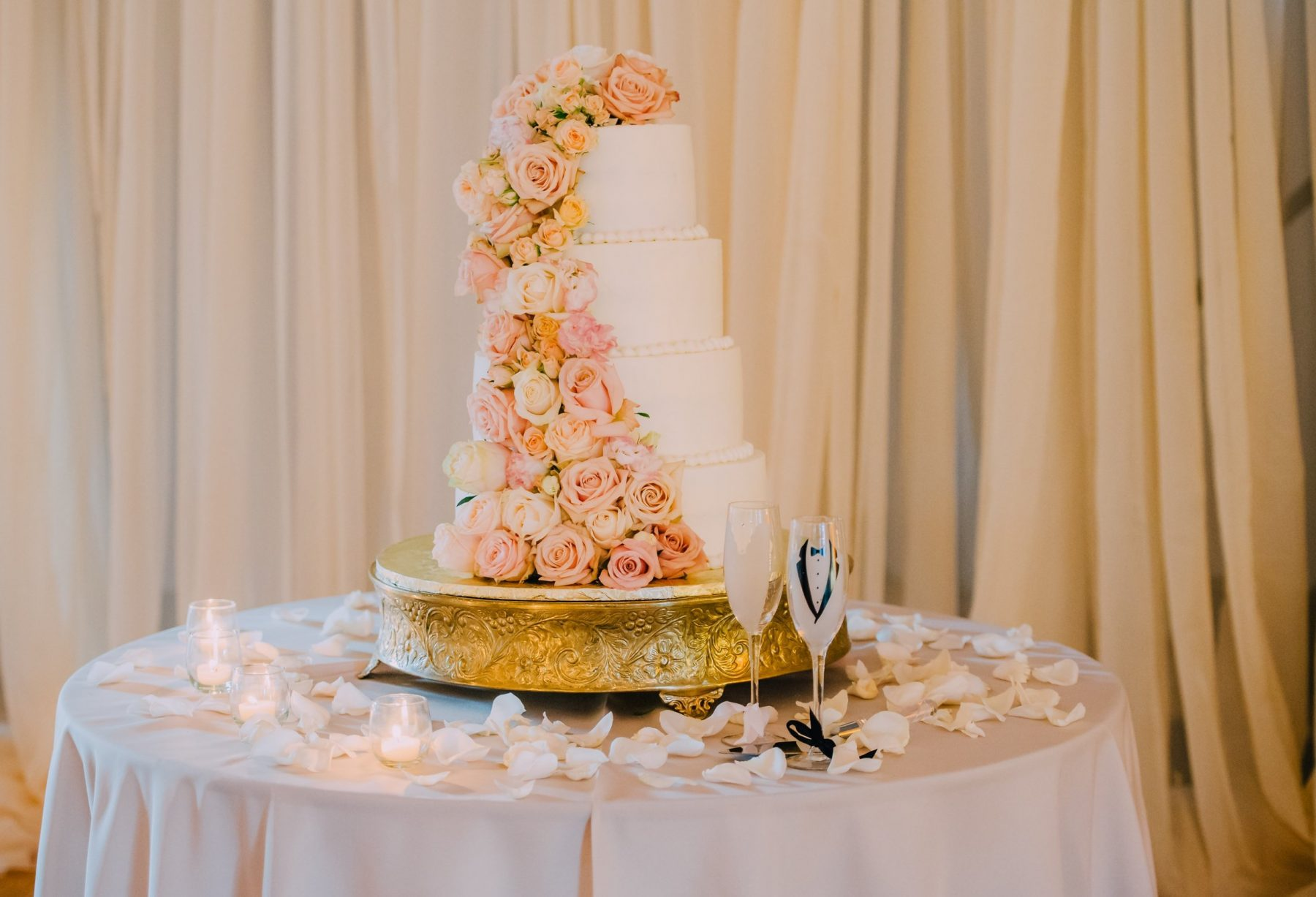 A wedding cake with champagne glasses